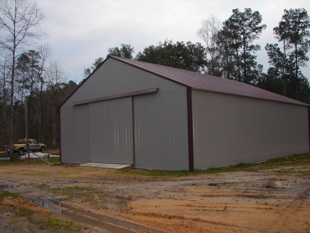 Armour metals pole barns metal roofing and pole barns for Images of pole barns